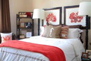 red artwork and pillows in bedroom